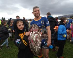 Henry MacKay (9), of Wanaka, was one of many who waited to have their photo taken with Otago team...