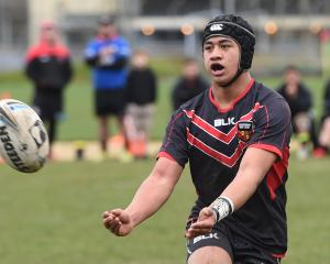 Canterbury 15s player Matthew Logopati passes during his team's game against West Coast yesterday