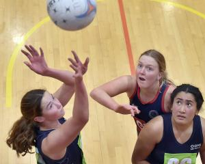 Otago Girls' goal attack Charlotte Underwood-Nicol shoots for goal in front of Southland Girls'...