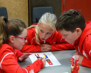 St John's Primary pupils (from left) Paige Smith (10), Chloe McAuley (9) and Fred Dowling (9)...