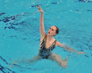 Eva Morris (Tauranga) competes during the free solos at the national artistic swimming...