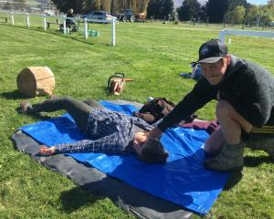 Josh Johanson, of Ida Valley, tries out his first-aid knowledge on volunteer Chloe Rosser, of...