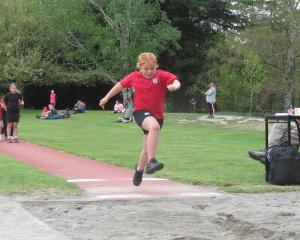 Ashburton Borough School pupil Quynn Geddes, 8, gives her all during the Year 3 long jump event.