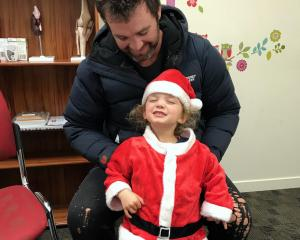 Lucy Lake (3) at the doctors — HealthCentral Alexandra — with her father, Willie. PHOTO: SUSAN...