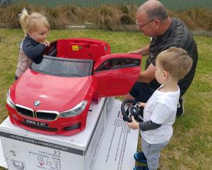 ''Pop'' Trevor Bell with his two helpers Penelope Bell (3) and Spencer Bell (2) in Cromwell...