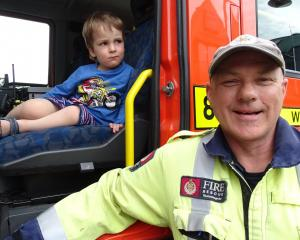 Tom Houghton (2), of Christchurch, and Wanaka volunteer Fenz firefighter Clayton Sargisson.