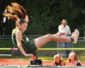 Kassia Barrett (13), of East Otago High, gets over the bar during a high jump event at the Otago...