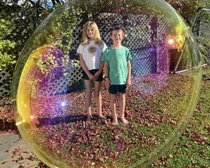 Anna (10) and William (7) Hepburn in their backyard bubble at home in Maori Hill. PHOTO: AL HEPBURN
