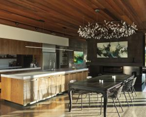 Oak cabinetry and a cedar-clad ceiling feature in the kitchen-dining area.