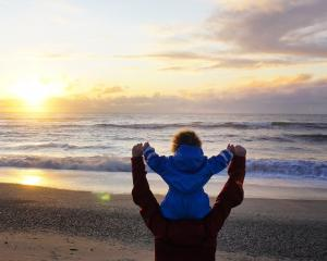 Sian and Lucy Elder watch the spectacular sunset on Haast Beach. PHOTOS: ELDER FAMILY PHOTOS