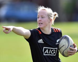 Black Ferns halfback Kendra Cocksedge (top right) directs traffic while (in order through...