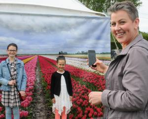 Anna Murdoch takes a picture of Emily Irvine (11, left) and Mia Murdoch (6) at the Triflor's...