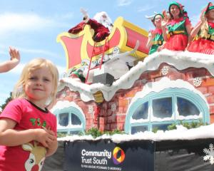 Pyper Brown was thrilled to see Santa Claus during the Southland Christmas Parade. PHOTOS: LUISA...