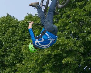 Levi Goodall, of Gore, practises one of his freestyle mountain bike stunts at the South Otago A &...