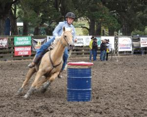 Invercargill's Blake Mouat rounds a barrel in the junior barrel race.