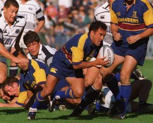 Highlanders halfback Stu Forster makes a burst against the Blues in a pre-season game at 