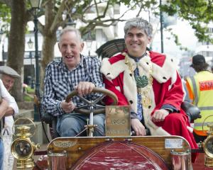 Brighton Veteran Car Rally organiser Colin Winter drives Dunedin Mayor Aaron Hawkins. PHOTOS:...
