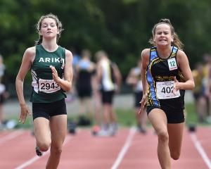 Emelia Adamson (left) (12) and Shanti Kara (11) race in the under-12 100m race .