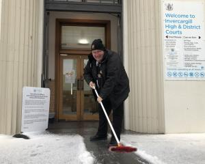 Invercargill High Court and District Court security guard Stewart Saunders clears the entrance to...