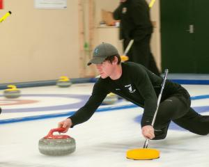 New Zealand Youth Olympics representative Hunter Walker delivers a stone at the  New Zealand...