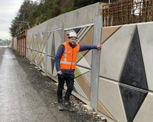 NZ Transport Agency senior project manager Jason Forbes admires the taniwha wall mural, designed...