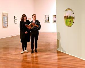 Curators Lauren Gutsell (left) and Lucy Hammonds prepare for the upcoming ''Joanna Margaret Paul:...
