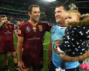 Queensland's Cameron Smith (L) and New South Wales' Paul Gallen after the match. Photo Getty