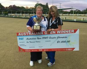 Dunedin's Carolyn Crawford (left) holds the winner's cheque with runner-up Pam Walker, of Lauder,...
