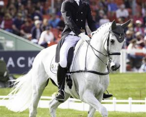 Clarke Johnstone, on Balmoral Sensation, competes in the dressage section of the Badminton Horse...