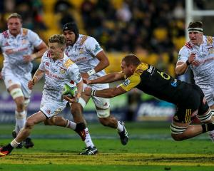 Damian McKenzie on the run for the Chiefs against the Hurricanes. Photo: Getty Images