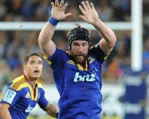 Andrew Hore attempts to charge down a kick during the Highlanders-Blues Super 15 rugby match at...