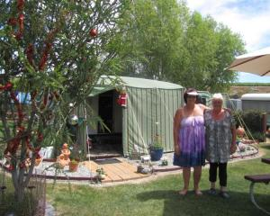 Bannockburn Domain camping ground caretaker Jane Scott (right) and ''Millionaires Mile'' camper...