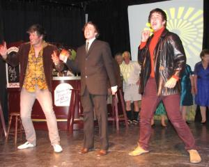 Beatle Mania '64 actors (from left) James Stephenson, Sam Farr and Mitch Martin sing New Zealand...