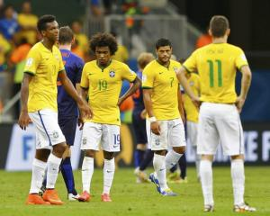 Brazil's Jo, Willian, Hulk and Oscar react after they lost their 2014 World Cup third-place...