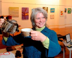 Judge Kim Pieters with a deerskin-covered tea set, Deer It Is, by Christchurch artist Tony...