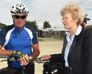 Minster of Conservation Kate Wilkinson discusses the Otago Central Rail Trail with cyclist Jeff...