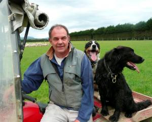Southland farmer Jeff Grant, who is standing for the board of Alliance Group, at home with two...
