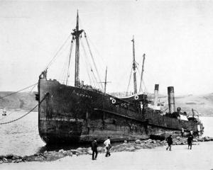 The Union Steam Ship Company's Kowhai, lying on the beach at the Spit, opposite Harington Point,...