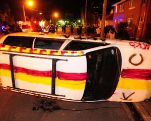 A car lies overturned in Castle St on Friday. Photo by Craig Baxter