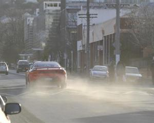 A car throws up a cloud of dust in Albany St, Dunedin, where airborne dirt and soil particles...
