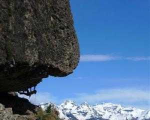 A climber hanging under the `Proud Monkey Roof' climbing route in Wye Creek. Photo by Guillaume...