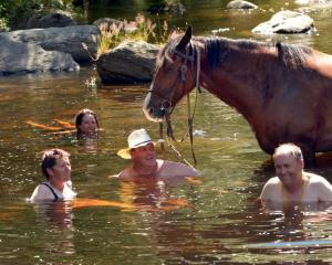 A dip in the Taieri River proves soothing for Annette O'Callaghan (Hindon), Casey Boland ...