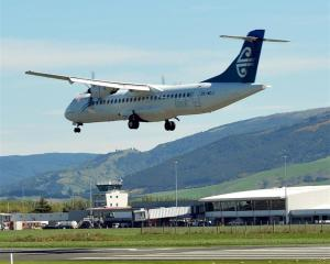 A flight lands at Dunedin Airport. Photo by ODT.