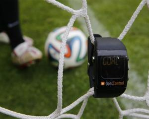 A GoalControl watch reads ''goal''  as a football rolls fully behind the goal line during a...