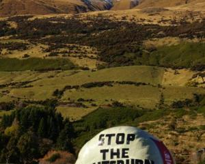 A hay bale in Glenorchy spreads a message of opposition to the proposed  Milford Dart  tunnel....