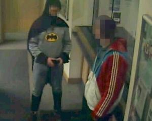 A man dressed as Batman and a burglary suspect stand in a police station in Bradford, northern...