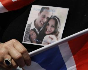 A picture of Prince William and Kate Middleton is seen on the T-shirt, and a ring similar to that...