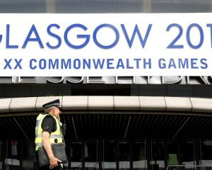 A police officer provides security in preparation for the Commonwealth Games in Glasgow. REUTERS...