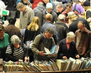 A section of the large crowd look for bargains at the Star Regent 24 Hour Book Sale at the Regent...