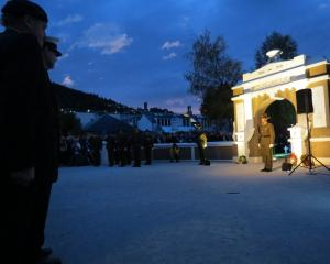 A soldier stands guard at the Memorial Gates in Queenstown on Saturday morning during the dawn...